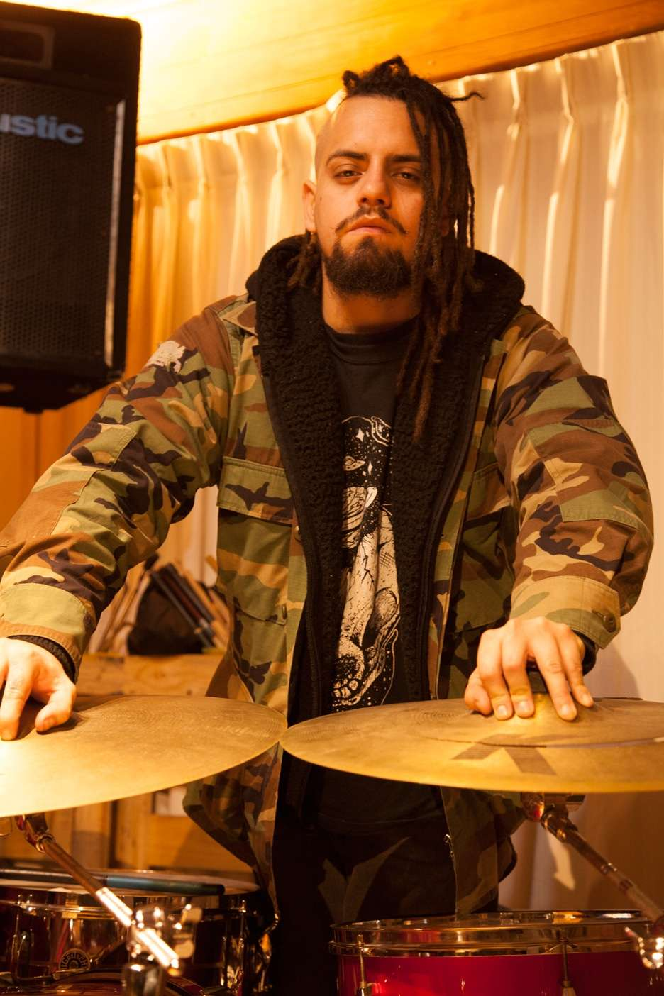 Drummer with Dark K Cymbals and militar camouflage jacket